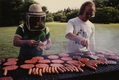 Ross Clark (L) and Chad Avery (R) grilling meat on Thornhill lawn at Employee picnic