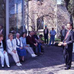 Gerry Donnelly speaking to employees in front of Administration Building rotunda on Arbor Day