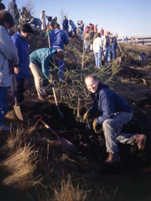 Tom Green and others planting tree on berm on Earth Day