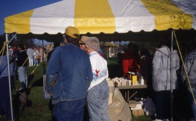 Duane Henry and Helen Langrill outside of tent during Earth Day celebration near the berms