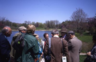 Crowd listening to talk facing Meadow Lake on Arbor Day