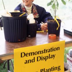 Employee at Demonstration and Display and Proper Planting Practices table during Arbor Week