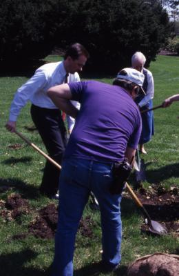 Gerry Donnelly, Doug Monroe, and Helen Langrill digging hole for Arbor Day tree planting