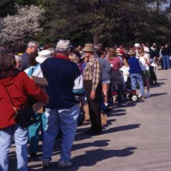 Long line of customers waiting outside Arbor Day Plant Sale tent