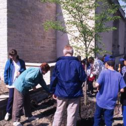 Children and adults with shovels planting Arbor Day tree at Thornhill Education Center