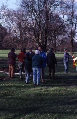 Employees gathered at Arbor Day employee tree planting
