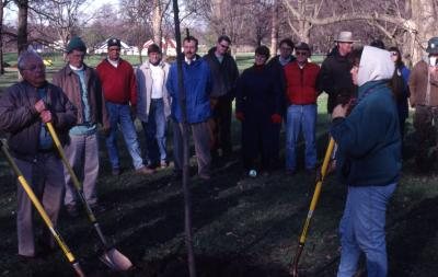 George Ware with shovel at Arbor Day employee tree planting
