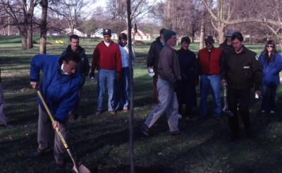 Gerry Donnelly with shovel at Arbor Day employee tree planting