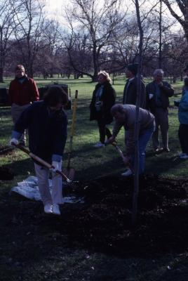 Two employees with shovels at Arbor Day employee tree planting
