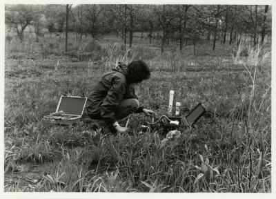 Kim Allen monitoring soil moisture in Schulenberg Prairie