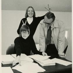 The Morton Arboretum Quarterly publication staff reviewing survey results at desk in Administration Building