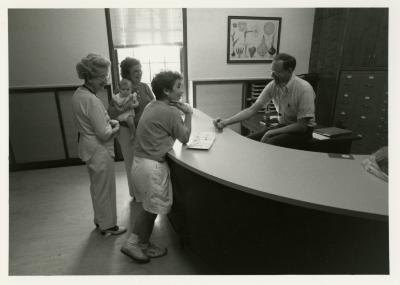 Ed Hedborn assisting visitors at Plant Clinic desk