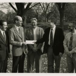 John Hendricksen presenting check in Hedge Garden for Gary Watson's research into root damage caused by construction activities