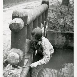 Glen Drake repairing bridge near Lake Marmo