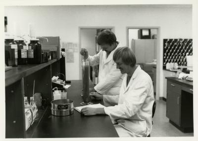 Pat Kelsey (left) and Rick Hootman soil testing in the lab