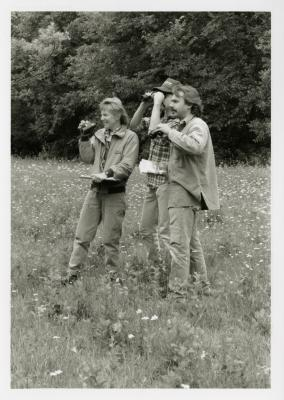 Chris Whelan and two others with binoculars in the field for bird study