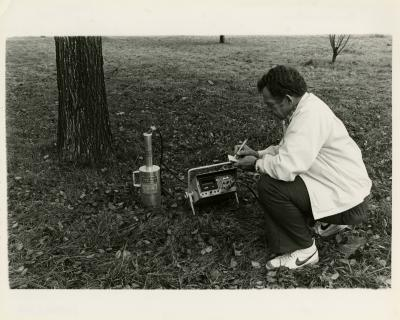 Steve Messenger with nuclear probe testing  soil moisture in the field