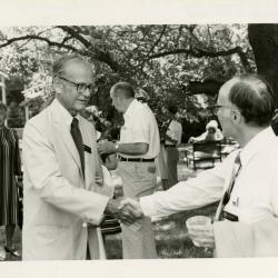 Research Building dedication - Larry Carton (left) and Marion Hall shaking hands, Suzette Davidson in background on lawn near Research Building