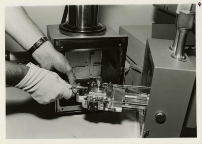 Scanning Electron Microscope (SEM) research - William Hess placing the coated specimen on stage into the specimen chamber