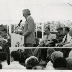 Research Building dedication - Russell Beatty, keynote speaker, at podium in tent - (Seated L to R): George Ware, Suzette Morton Davidson, Charles Haffner III, Marion Hall