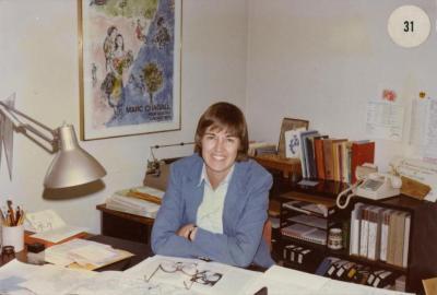 Carol Doty at desk