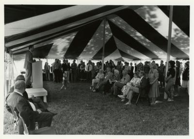 Tony Tyznik Retirement Party in tent - Gerry Donnelly addressing guests from podium