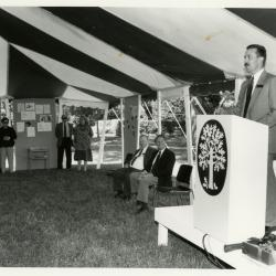 Tony Tyznik Retirement Party in tent - Gerry Donnelly addressing guests at podium - (Seated L to R): Tony Tyznik, Gerry Donnelly