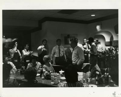 Guide Party for Dick Wason Retirement at a restaurant - Dick Wason gesturing while restaurant staff sing