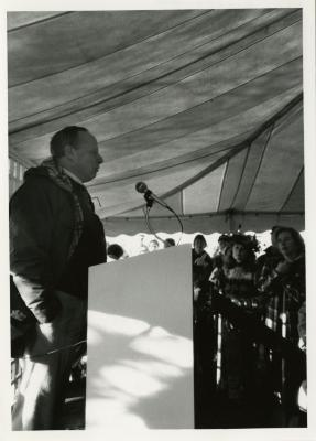 Earth Day - Charles Haffner at podium in tent