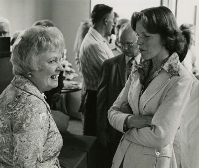 Evelyn Rasch Naser Retirement Party in tea room - Evelyn Naser (left) and Nancy Hart in conversation