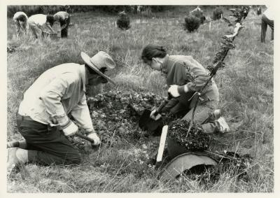 Earth Day - Charles Lewis and Rita Hassert planting; staff berm planting party