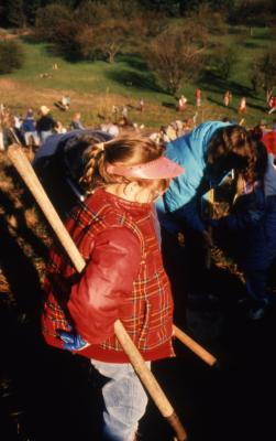 Young girl with shovel during Earth Day celebration and berm planting