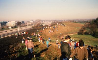 Overlooking crowd on berm along I-88 for Earth Day celebration and berm planting