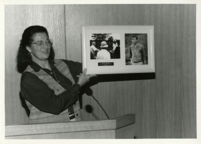 Jane Balaban, eyes closed, showing photos at Swink-Wilhelm book signing at Thornhill