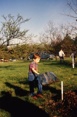 Small boy with big shovel during Earth Day celebration and berm planting