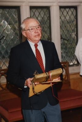 George Ware Retirement Party in Founders Room - George Ware holding gift