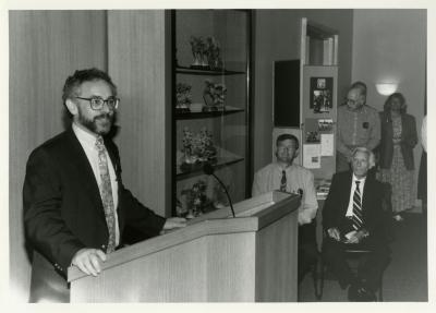 Christopher Dunn addressing group at Swink-Wilhelm book signing at Thornhill - closeup shot (Jerry Wilhelm and Floyd Swink seated)