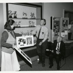 Jane Balaban and Jerry Wilhelm holding photos at Swink-Wilhelm book signing at Thornhill (Floyd Swink seated)