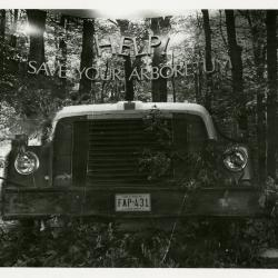 """""""Help Save Your Arboretum"""" sign over truck in woods - exhibition for rally against FAP 431 toll road"""