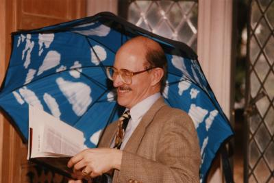George Ware Retirement Party in Founders Room - Michael Stieber with Magritte umbrella