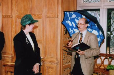 George Ware Retirement Party in Founders Room - Nancy Stieber in green cap; Michael Stieber with Magritte umbrella