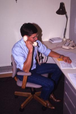 Plant Clinic work station, John Beckett on phone