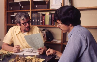 Web Crowley showing document to Bill Stickney while reviewing plant specimens in Plant Clinic