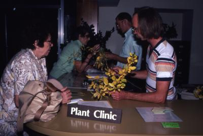 Chad Avery and Ed Hedborn helping visitors at Plant Clinic counter