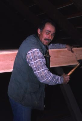 Bill Bergmann with hammer and board