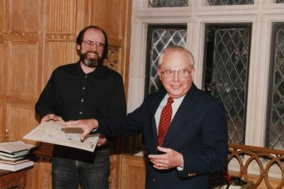 George Ware Retirement Party in Founders Room - Tony Byrne and George Ware laughing over cartoon