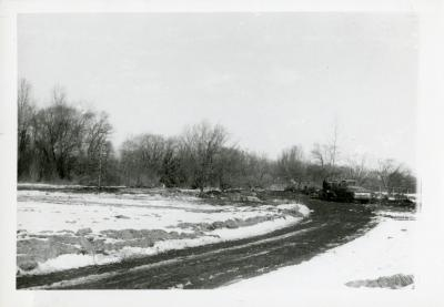 Reconstruction of Arboretum entrance drive in winter when Route 53 was widened showing road curve to left