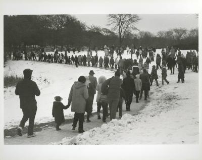 Yule Log Hunt - group walking in snow in the East Side of the Arboretum