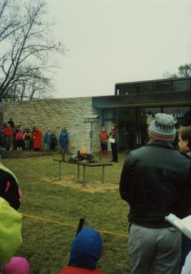 Yule Log Hunt - log burning, Carol Doty talking outside the Visitor Center
