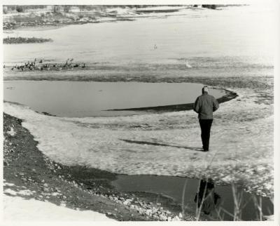 Alfred Etter observing ducks & geese on Arbor Lake in winter